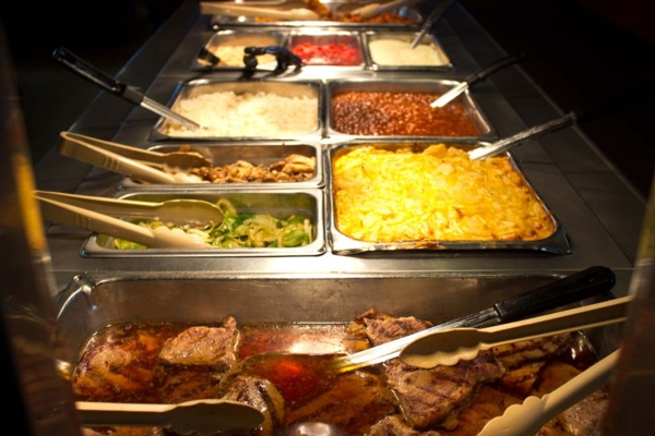 steak, baked beans and rice at buffet